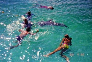 snorkelers playing with JoJo