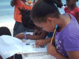 Children recording data on West Road Beach.